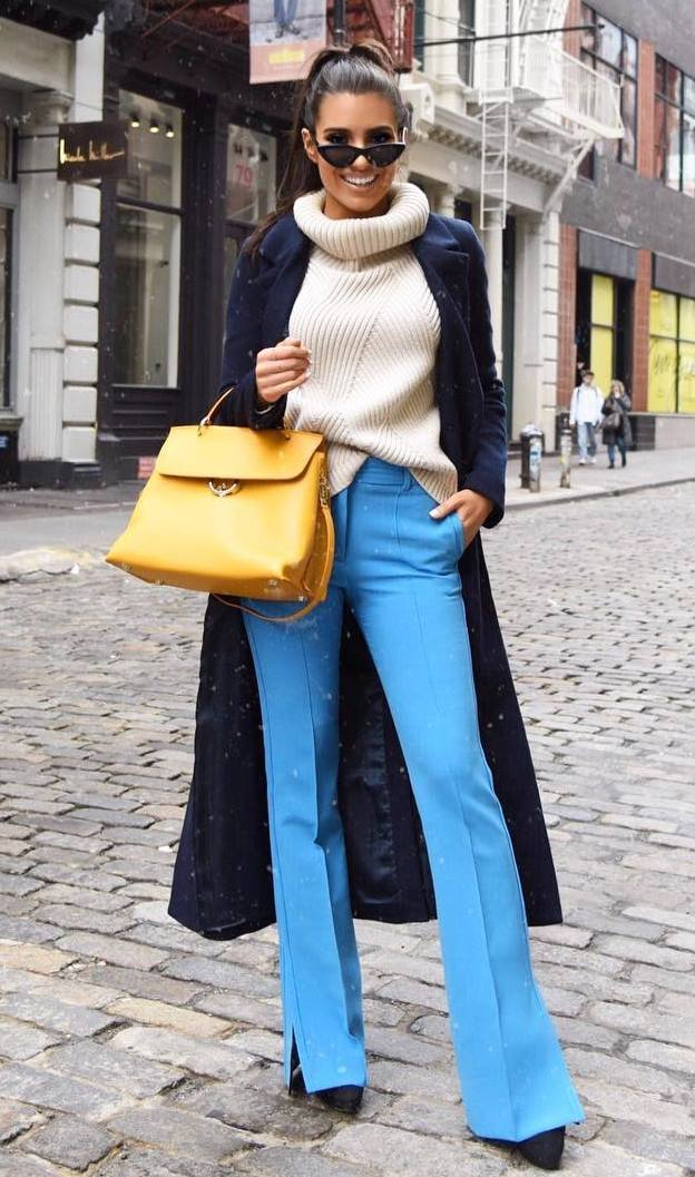 elegant fall outfit idea with a knit sweater : long coat + yellow bag + heels + blue pants