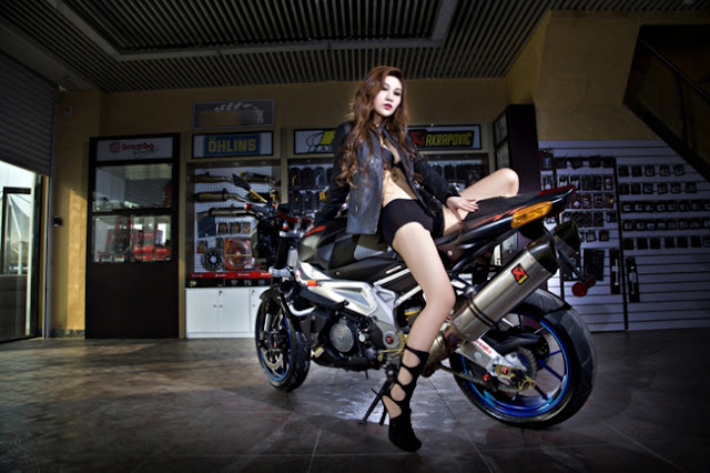 Girl on aprilia motorcycle