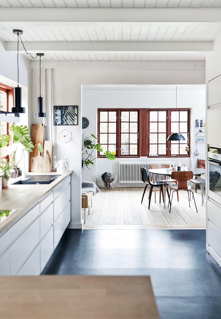 Kitchen design, dining chairs and table, black floor, scandinavian interior, home decor
