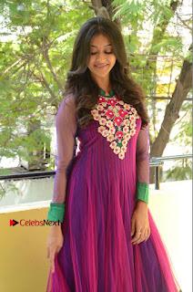 Actress Pooja Jhaveri Latest Stills in Purple Salwar Kameezt at Dwaraka Success Meet  0036.JPG