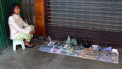 small street side shop with natural but low quality jade items