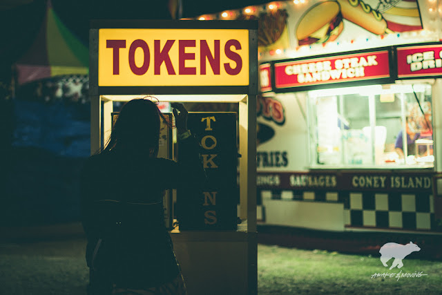 Tokens to buy food. Oh, carnival tricks...