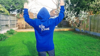 Dan Jon wearing his The Kid Who Would Be King Hoodie whilst being circled by a Police Helicopter