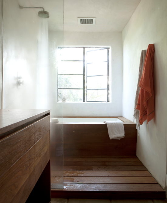 Wooden floor, cabinetry and bathtub. Image by Amy Neunsinger.