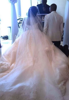 Front and back view of  Tolu Oniru's AKA Toolz wedding gown with her husband
