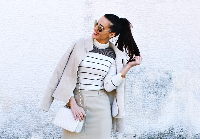 Mexx mini skirt.Beige striped turtleneck.Zara chain purse.Beige shearling jacket.H&M sunglasses, earrings and cuff.