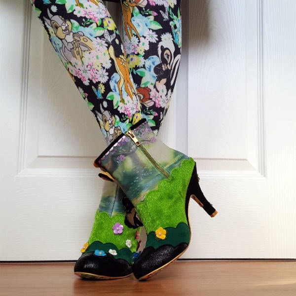 zip fastening on ankle boots, legs wearing Bambi pattern tights