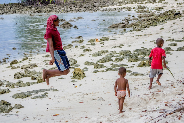 kids playing on the beach, sea shell resort, havelock island