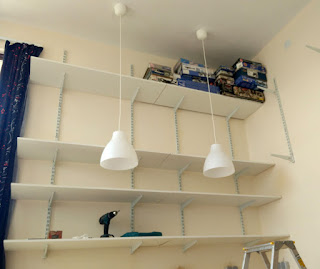 Seriously high shelving with model planes on top