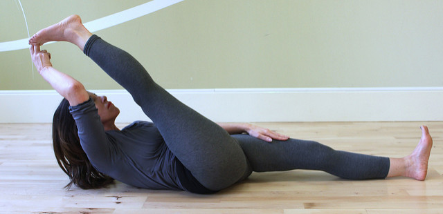 Yoga pose of the day: Supta Padangusthasana (Reclining hand-to-big-toe pose)
