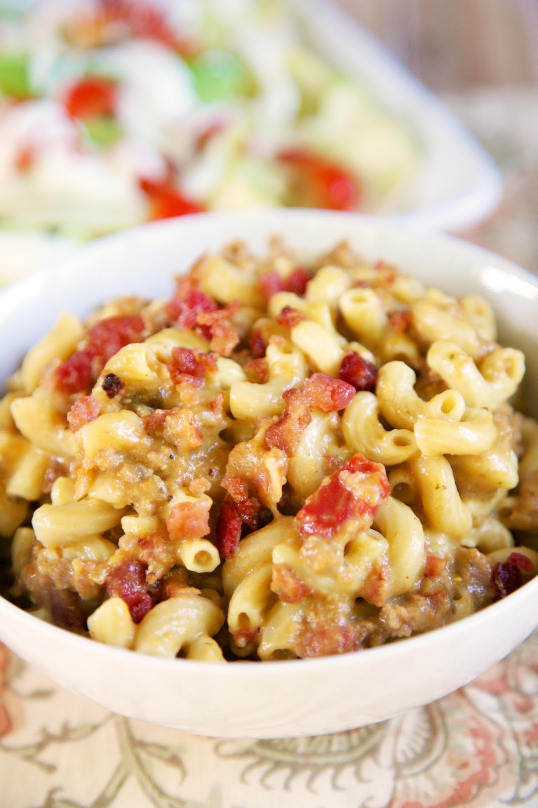 Slow Cooker Bacon Cheeseburger Pasta - FREEZER MEAL - just toss everything in a freezer bag for a quick meal later. Ground beef, bacon, onion, dry mustard, cream of chicken soup, Rotel tomatoes, beef broth, cheddar cheese and elbow macaroni. Kids go crazy over this easy slow cooker meal! No need to pre cook the ground beef or pre cook the pasta. It all cooks in the slow cooker. #slowcooker #freezermeal #groundbeef