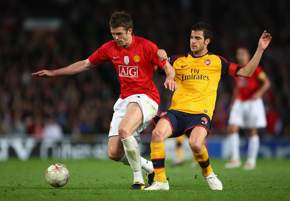 Cesc Fabregas of Arsenal battles for the ball with Michael Carrick of Manchester United during the UEFA Champions League Semi Final First Leg match between Manchester United and Arsenal at Old Trafford on April 29, 2009 in Manchester, England