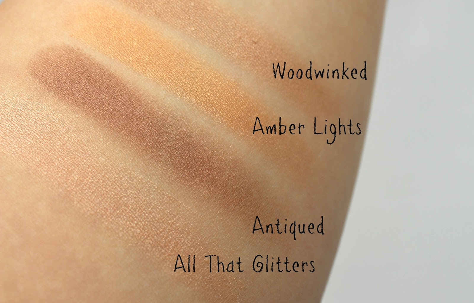 A picture of MAC Woodwinked, Amber Lights, Antiqued and All That Glitters eyeshadows swatches