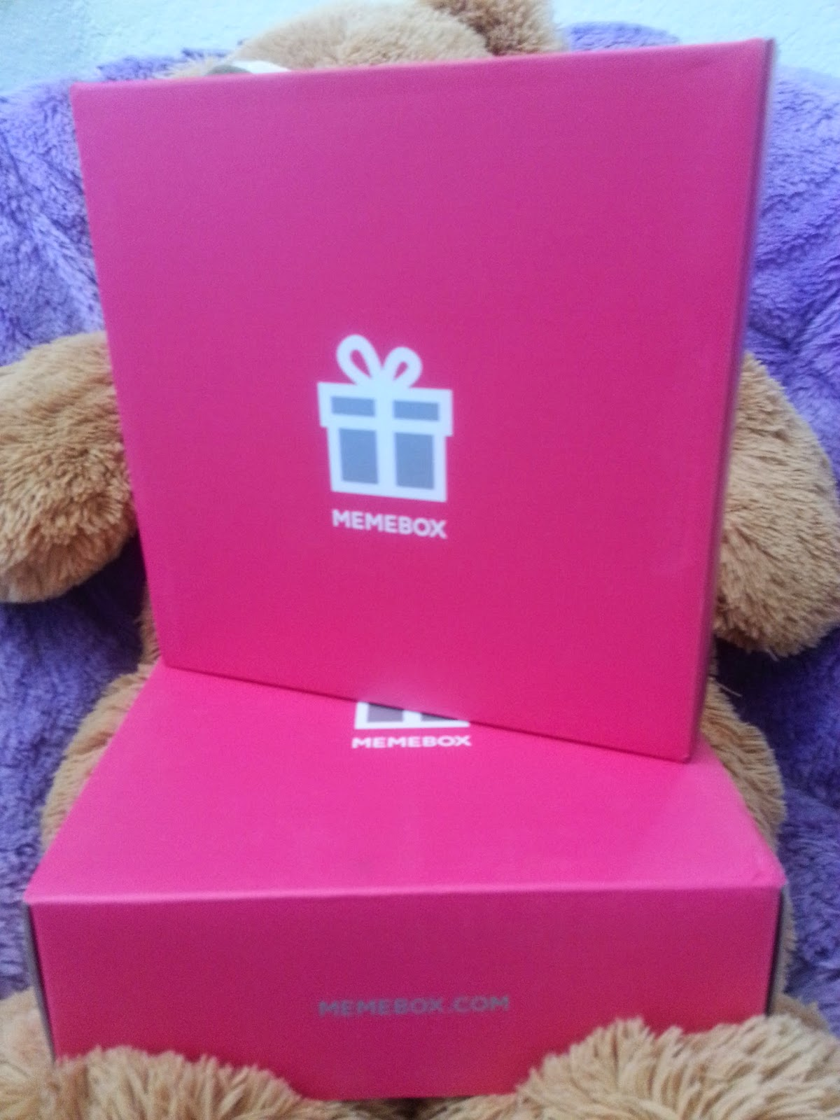Memebox's signature pink boxes.