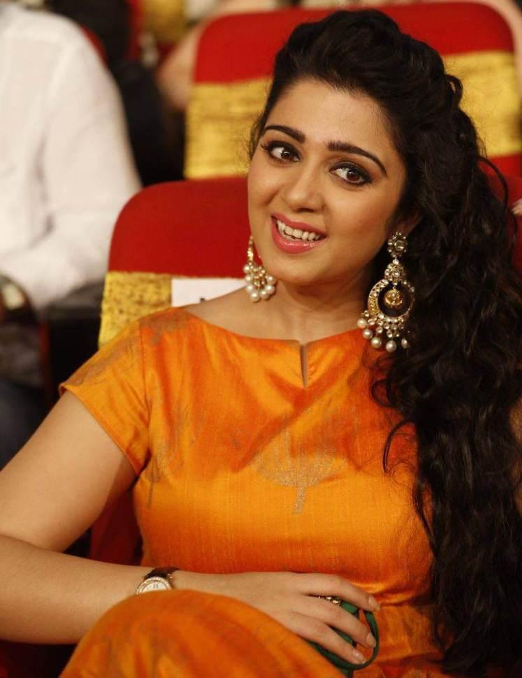 Charmi at TSR TV9 National Film Awards In Orange Dress