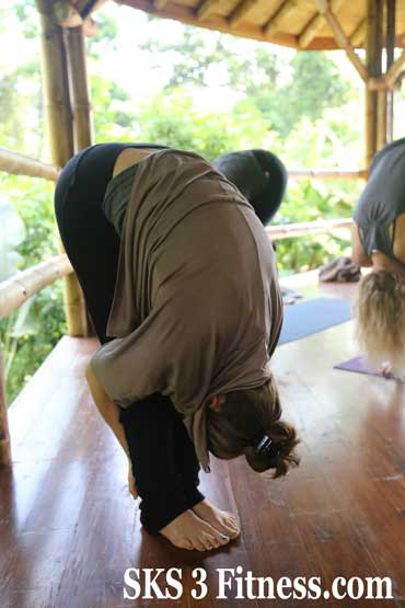 Yoga girl showing How to do Standing Forward Bend - Uttanasan Steps