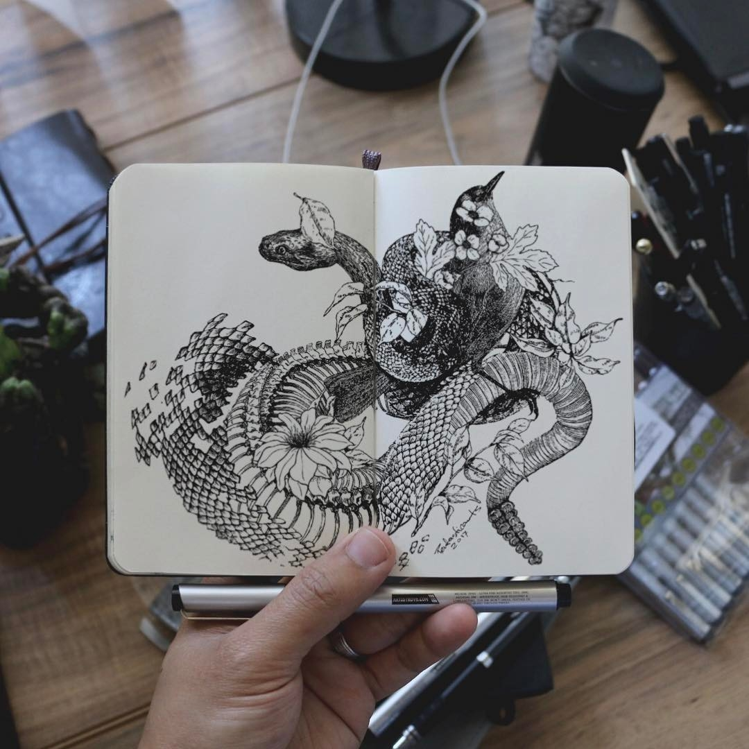 11-Snake-Shedding-Joseph-Catimbang-Doodle-Drawings-make-the-World-go-Round-www-designstack-co