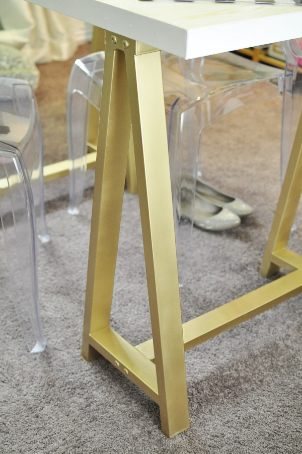 A gorgeous DIY gold faux bois sawhorse desk inspired by a $699 version from PB Teen. Tutorial and details available at monicawantsit.com
