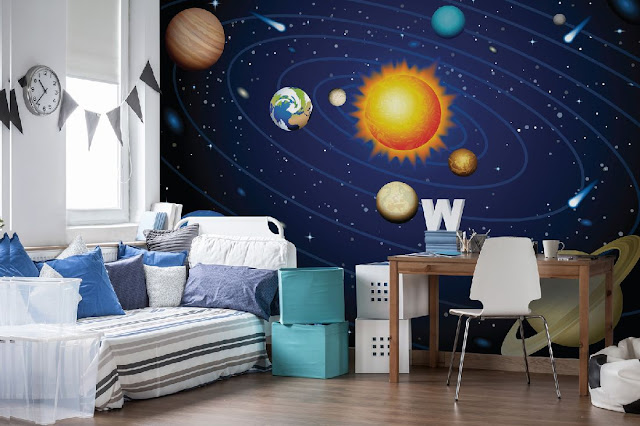 A childs bedroom showing a space wall mural