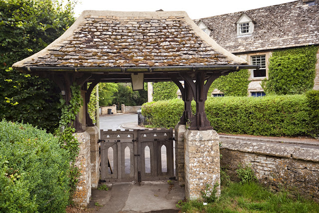 Lych gate at the KIngham church of St Andrews in the Cotswolds by Martyn Ferry Photography