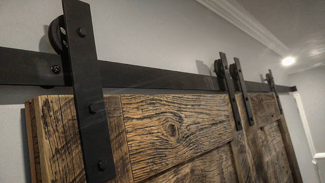 Rustic sliding barn doors with black hardware