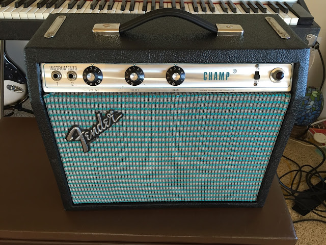 Beautifully restored Fender Champ amp front view