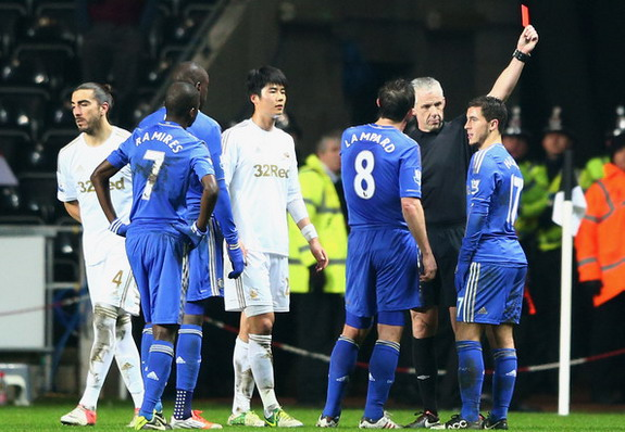 Chelsea player Eden Hazard is sent off by referee Chris Foy after kicking a ballboy