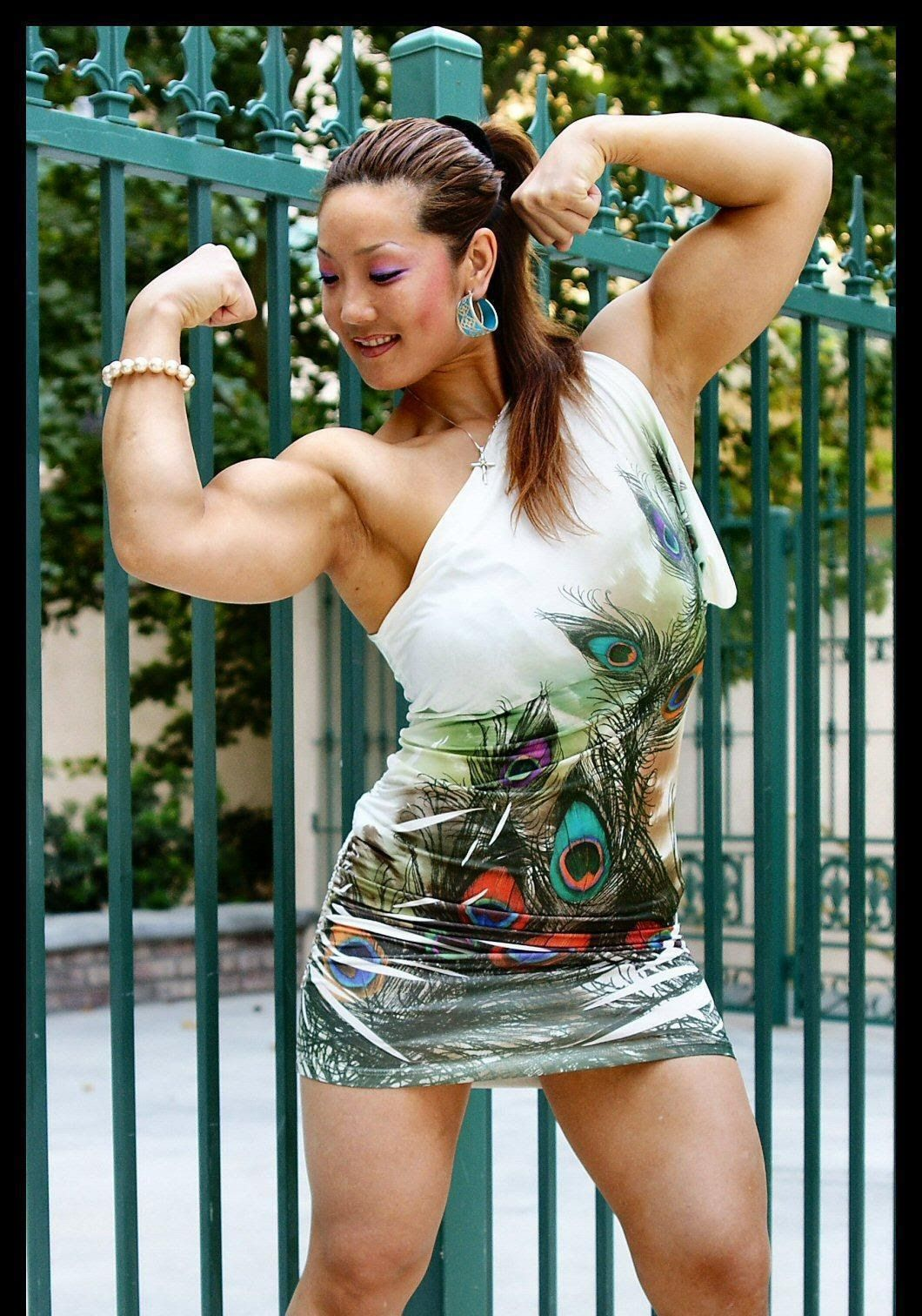 Muscular Womens Dressed: Xin Li Cao.