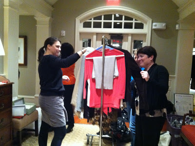 Volunteers sort the donations brought to Career Wardrobe collections at the Athertyn Residents' Clubhouse.
