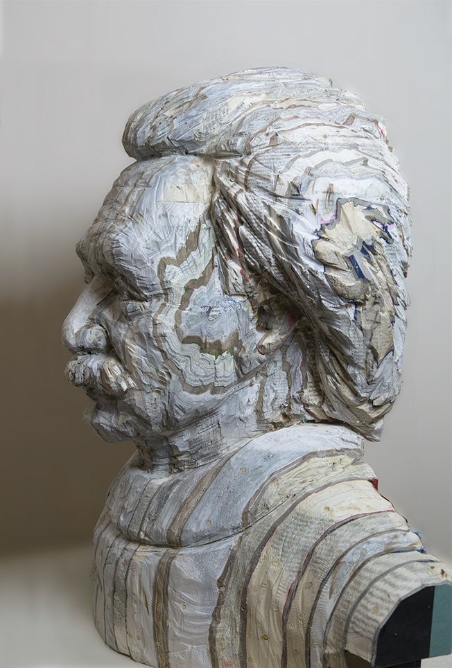 04-Einstein-Long-Bin-Chen-A-Second-Life-for-Recycled-Book-Sculpting-www-designstack-co