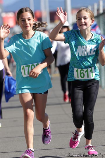 L-R: Paige Watson, Lily Hasselman, cousins, on Breakwater Rd, near the Napier Port, Napier - Events included 2016 Napier City Pak'nSave Half Marathon, a Half Marathon relay and 10km and Tremains 5km run/walk. photograph