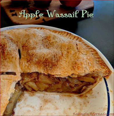 Add another layer of flavors to a holiday favorite, Apple Wassail Pie adds the flavors of the hot drink to your apple pie. | Recipe developed by www.BakingInATornado.com | #recipe #dessert
