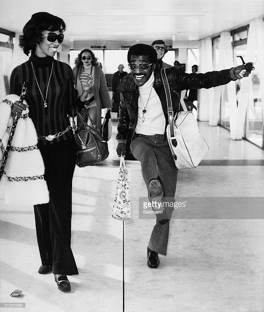 Altovise and Sammy Davis Jr. at Heathrow Airport