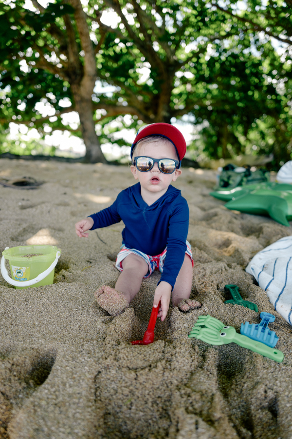 Toddler digging the sand