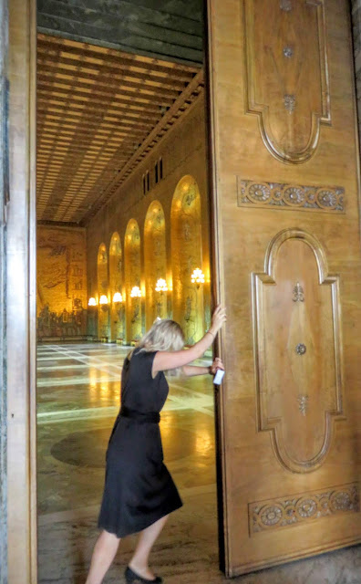 Opening the giant doors leading to the Golden Hall at Stockholm Stadshus