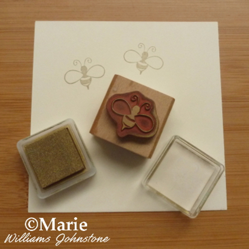 Printing bee design in gold color ink with wood backed rubber stamp