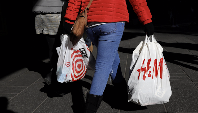 U.S. consumer spending roars back, but inflation tame
