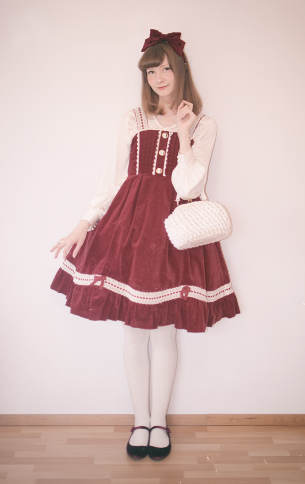 a finnish lolita posing in old school velvet metamorphose dress