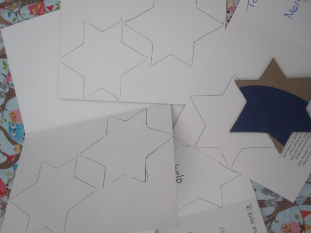 Christmas cards with stars drawn on them