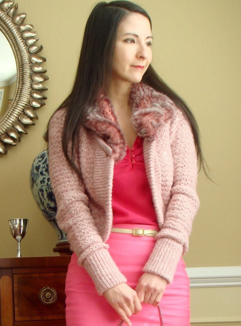 Valentine's outfit - Top of body- Wearing light pink fur trimmed short sweater with a bright  pink ruffled sleeveless top and bright pink pencil skirt with skinny gold belt.