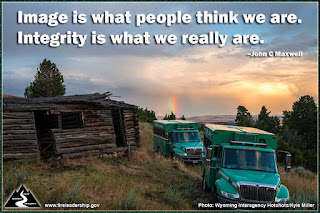Image is what people think we are. Integrity is what we really are. - John C. Maxwell (Hotshot buggies next to old cabin)