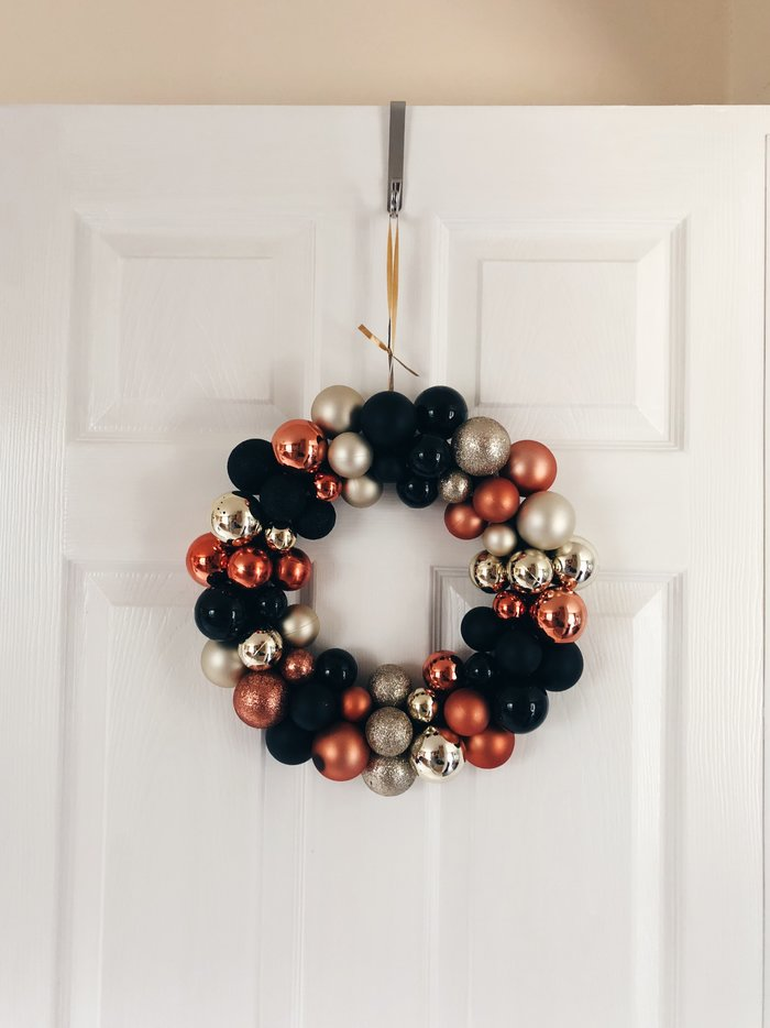 black orange and gold bauble wreath