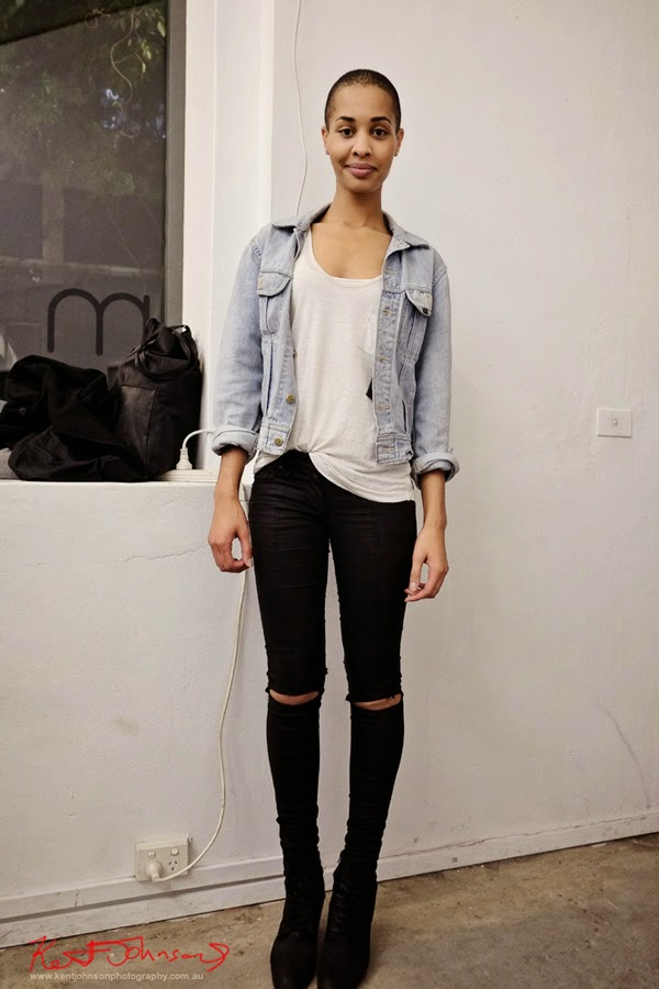 Model Lucy Blay wears ripped black jeans white tee shirt and faded denim jacket. Street Fashion Sydney by Kent Johnson.