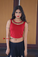 Telugu Actress Nishi Ganda Stills in Red Blouse and Black Skirt at Tik Tak Telugu Movie Audio Launch .COM 0350.JPG