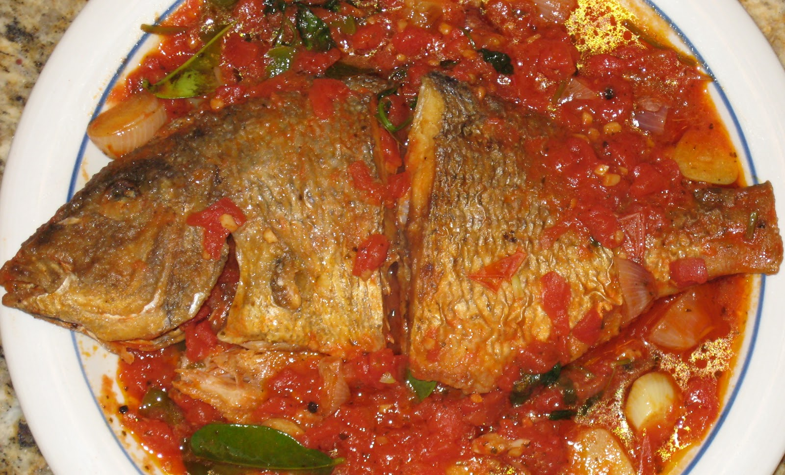 Fried porgy fish in tomato sauce for Recipes with fish sauce