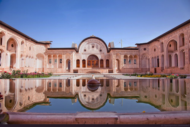 The arcs and columns of Tabatabai housereflected in a pool. Kashan
