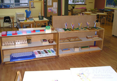 NAMC montessori prepared environment class decor wood shelving