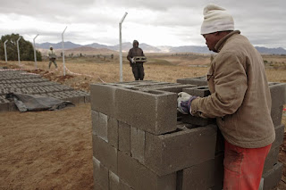 Africa Southern Lesotho metolong dam toilets brick making