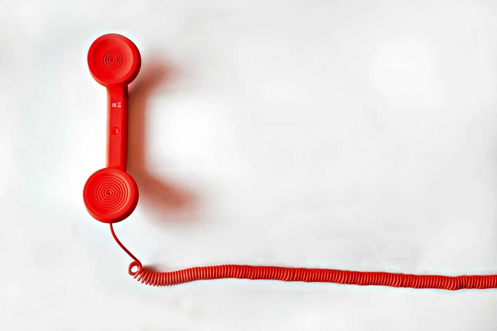 Red telephone handset and cord