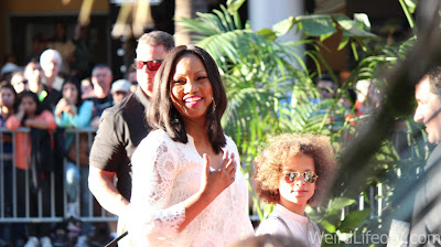 Garcelle Beauvais smiling at the fans